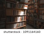 old cozy library. game of light ... | Shutterstock . vector #1091164160
