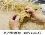 breakage of a loaf of bread... | Shutterstock . vector #1091165153
