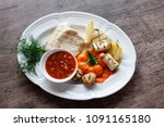 grilled fish fillet served with ... | Shutterstock . vector #1091165180