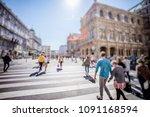 busy pedestrian crossing over... | Shutterstock . vector #1091168594