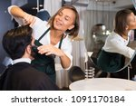 portrait of woman hairdresser...   Shutterstock . vector #1091170184