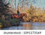 woman horseback riding through... | Shutterstock . vector #1091173169
