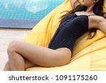 tanned skin asian woman in... | Shutterstock . vector #1091175260
