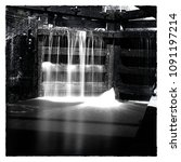 Small photo of Black and white Polaroid style canal lock gates shot with neutral density filter to allow smoothing of the pouring water. Shot in Nottinghamshire, UK on the Erewash canal.