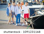 fashionable children by the sea ... | Shutterstock . vector #1091231168