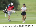 Small photo of PATTAYA, THAILAND-FEBRUARY 22: Muni He of China and caddie Round 1 of Honda LPGA Thailand 2018 on February 22, 2018 at Siam Country Club Old Course in Pattaya, Thailand
