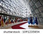 Small photo of Brussels, Belgium, 15 May 2018.Flags of UN and EU stand in European council Building.