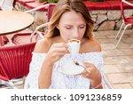 beautiful blond woman having... | Shutterstock . vector #1091236859