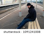 a man sits on a bench and waits ...   Shutterstock . vector #1091241008