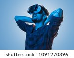 cheerful casual man wearing vr... | Shutterstock . vector #1091270396