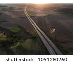 Aerial View Of Highway Leading...