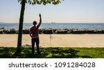 a sad man or boy standing alone ... | Shutterstock . vector #1091284028
