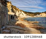 cala d'hort beach and boat... | Shutterstock . vector #1091288468