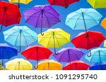 colorful umbrellas background.... | Shutterstock . vector #1091295740