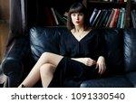 brunette in black dress on... | Shutterstock . vector #1091330540