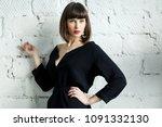 photo of young brunette in... | Shutterstock . vector #1091332130