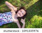 joyful girl is lying on the... | Shutterstock . vector #1091335976