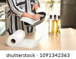 woman wiping frying pan with... | Shutterstock . vector #1091342363