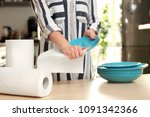 woman wiping ceramic plate with ... | Shutterstock . vector #1091342366