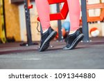 athletic woman sitting on a gym ... | Shutterstock . vector #1091344880