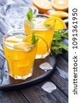 orange cocktail with ice and... | Shutterstock . vector #1091361950