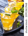 orange cocktail with ice and... | Shutterstock . vector #1091361968