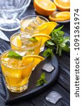 orange cocktail with ice and... | Shutterstock . vector #1091361974