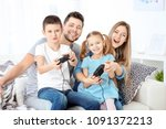 happy family playing video... | Shutterstock . vector #1091372213