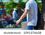 a guy with a smartphone is... | Shutterstock . vector #1091376638