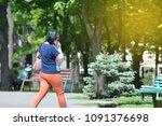 a woman walks and talks on a... | Shutterstock . vector #1091376698