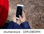 mobile phone in kids hand | Shutterstock . vector #1091380394
