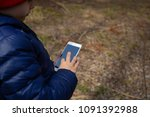 little boy using mobile phone | Shutterstock . vector #1091392988