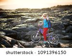 young tourist cycling on lava... | Shutterstock . vector #1091396150