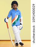 a boy in a cricketer's outfit   Shutterstock . vector #1091400029