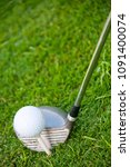 Small photo of A golf club and a golf ball