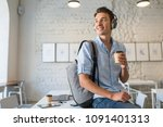 young handsome man sitting on...   Shutterstock . vector #1091401313