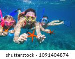 portrait of a family diving the ... | Shutterstock . vector #1091404874