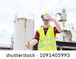 worker wearing reflective vest... | Shutterstock . vector #1091405993