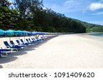loungers and umbrella on beach... | Shutterstock . vector #1091409620