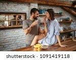 young couple enjoying coffee... | Shutterstock . vector #1091419118