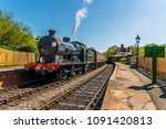 steam trains at a station on a... | Shutterstock . vector #1091420813