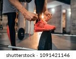 cropped shot of a man tying his ... | Shutterstock . vector #1091421146