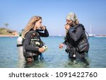 Scuba Divers Checking The Air...