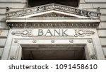 ornate bank entrance facade | Shutterstock . vector #1091458610