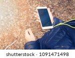 little boy uses the phone... | Shutterstock . vector #1091471498