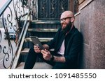 young hipster man blogger in... | Shutterstock . vector #1091485550