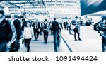 blurred people at a trade fair... | Shutterstock . vector #1091494424