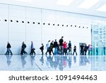 blurred people at a trade fair... | Shutterstock . vector #1091494463