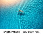 aerial view of swimming woman... | Shutterstock . vector #1091504708