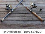 two fishing rods on wooden... | Shutterstock . vector #1091527820